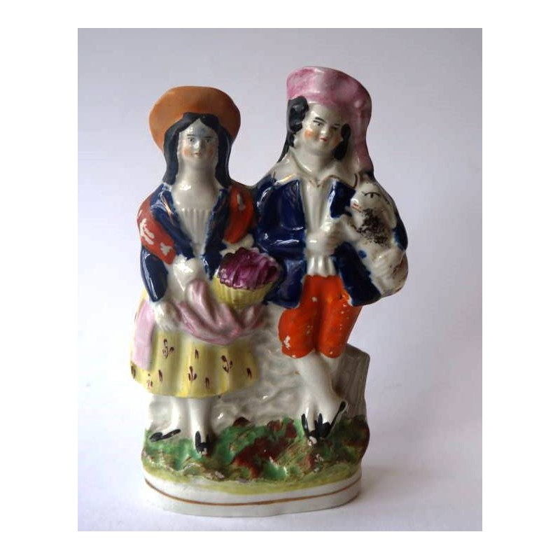Staffordshire Pottery Boy and Girl