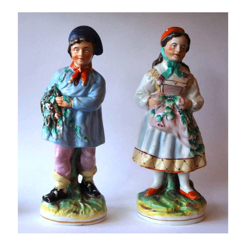 Staffordshire Pottery Boy and Girl pair