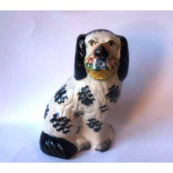 Staffordshire Pottery single Spaniel holding flower basket