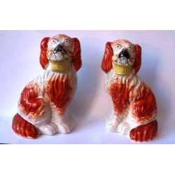 Staffordshire Pottery pair Spaniels with flower baskets