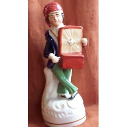 Staffordshire figure of Hurdy Girdy Player