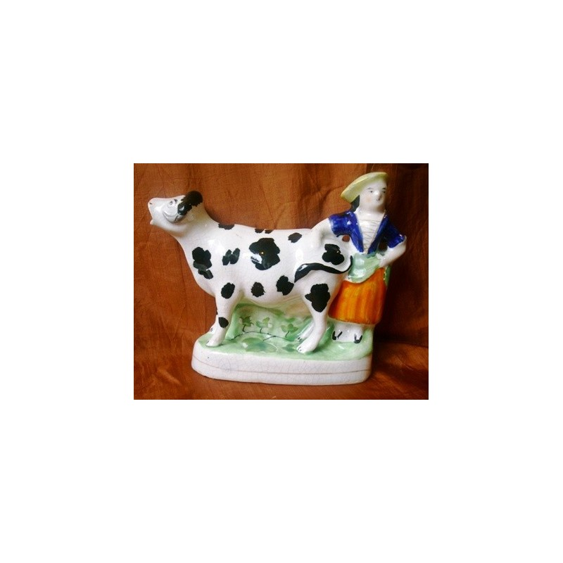 Black patch cow and milkmaid