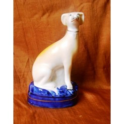 Seated small Greyhound