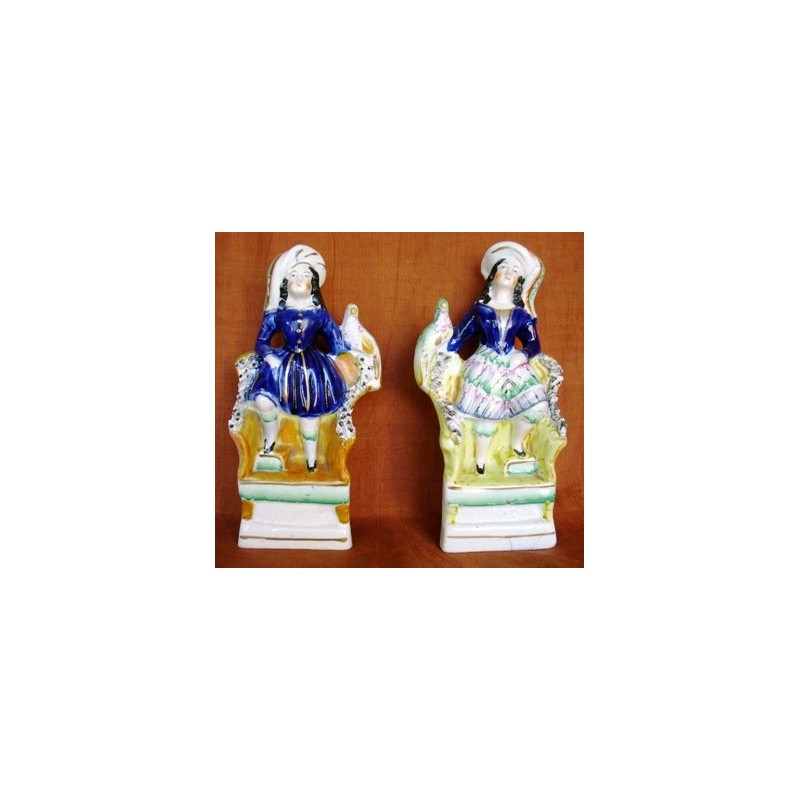 Staffordshire Pottery children with exotic bird, pair