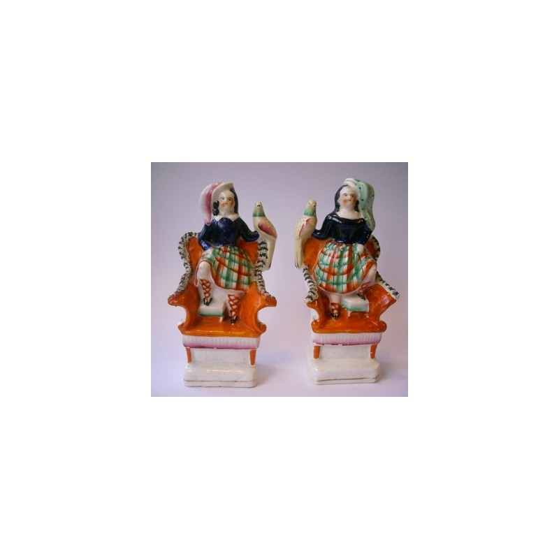 Staffordshire Pottery children with exotic birds.Pair
