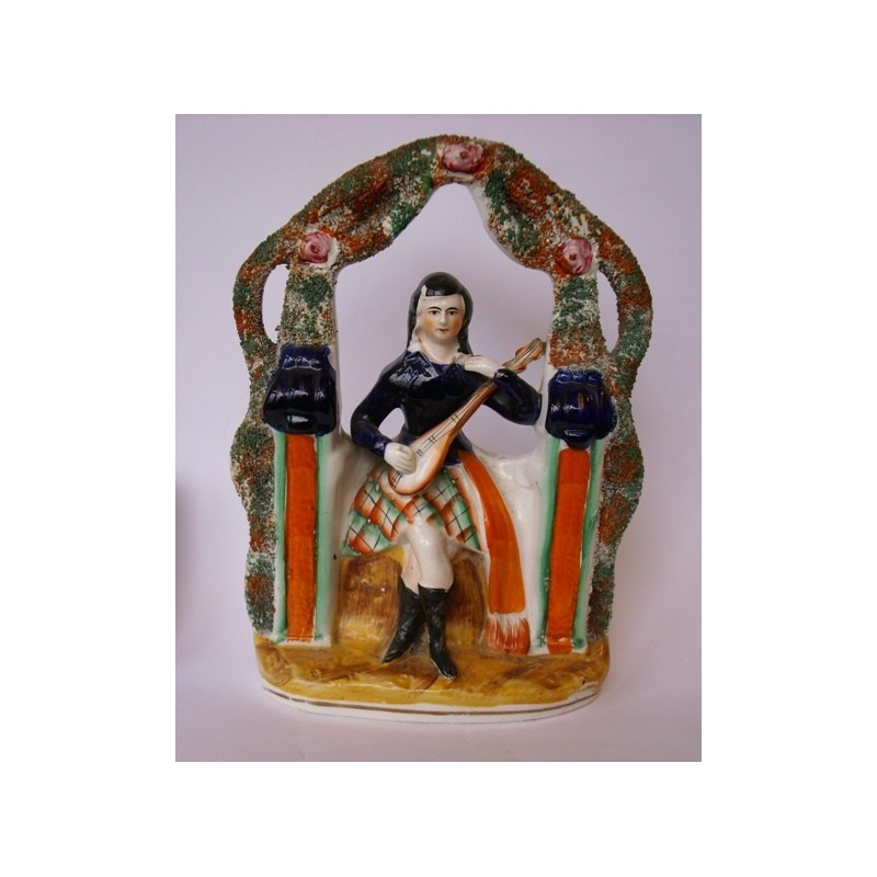Staffordshire Pottery seated musician