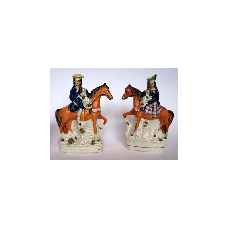 Equestrian boy and girl with Spaniels. Pair