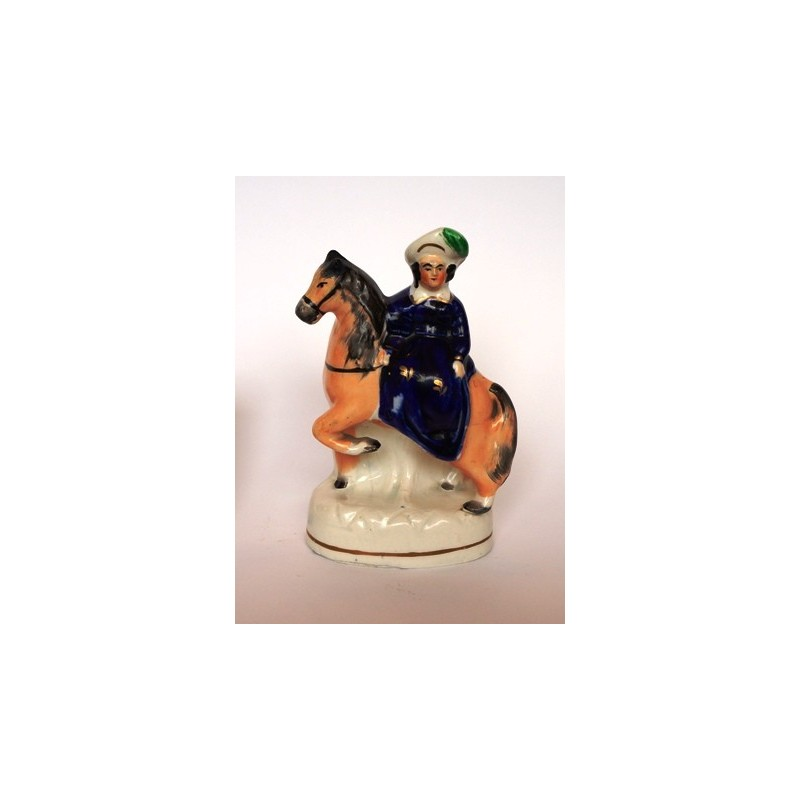 Staffordshire figure of Child on a pony