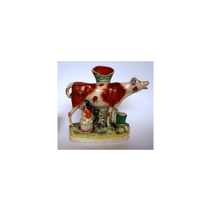 Cow and attendant