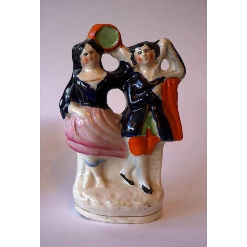 Staffordshire figure of Esmeralda and Gringoire