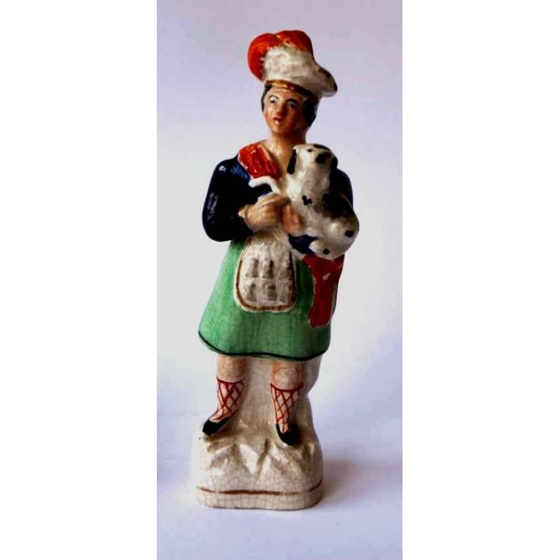 Scotsman holding dog