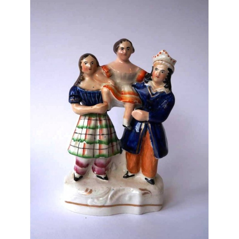 Staffordshire Pottery Group of three performers